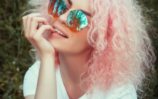 lady with pink hair thinks about hair dye when pregnant