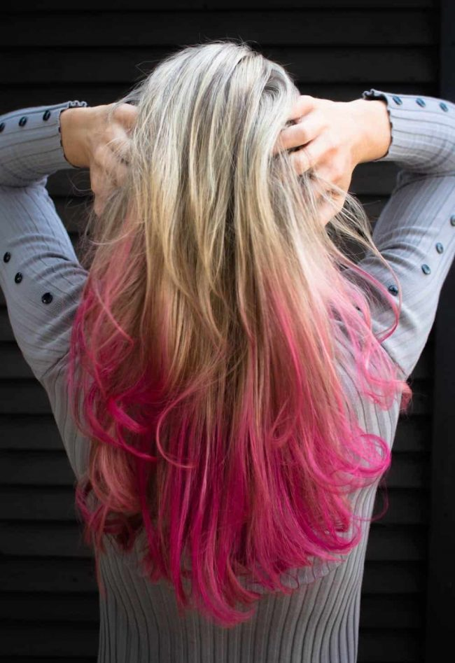 Girl with coloured hair pink hair care