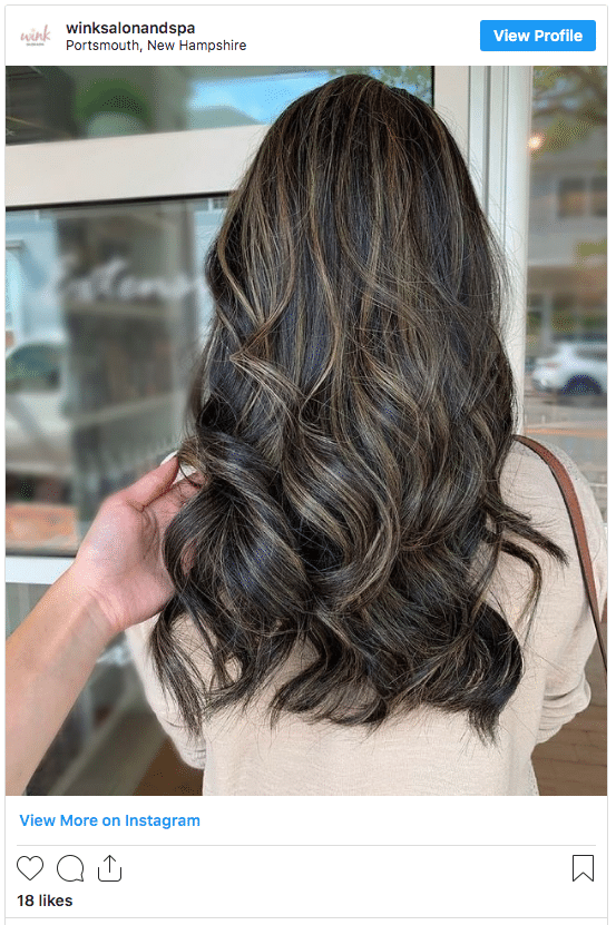 black hair with caramel brown highlights instagram post