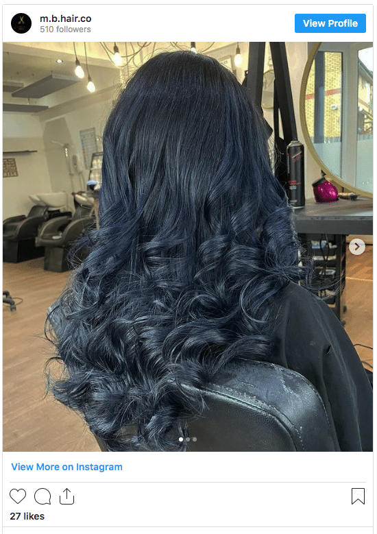 black hair with midnight blue highlights instagram post